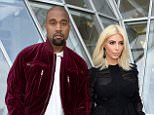 PARIS, FRANCE - MARCH 11:  (L-R) Kanye West and Kim Kardashian attend the Louis Vuitton  show as part of the Paris Fashion Week Womenswear Fall/Winter 2015/2016 on March 11, 2015 in Paris, France.  (Photo by Pascal Le Segretain/Getty Images)