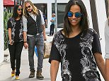 UK CLIENTS MUST CREDIT: AKM-GSI ONLY EXCLUSIVE: Malibu, CA - Zoe Saldana and Marco Perego walk hand in hand back to their car after some lunch and shopping in Malibu. The lovebirds ate at Taverna Tony before picking up a few items for their twins at Kitson Kids.  Pictured: Zoe Saldana Marco Perego Ref: SPL977023  150315   EXCLUSIVE Picture by: AKM-GSI / Splash News