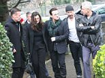 U2 in Dublin, attending a funeral mass.  Pictured: U2 attend a funeral mass in dublin, ireland. Their close friend, Tony Fenton died from cancer last thursday, age 53. Ref: SPL975731  160315   Picture by: Mark Doyle / Splash News  Splash News and Pictures Los Angeles: 310-821-2666 New York: 212-619-2666 London: 870-934-2666 photodesk@splashnews.com