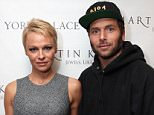 Actress Pamela Anderson and Rick Salomon attend The Martin Katz Jewel Suite Debuts At The New York Palace Hotel on November 13, 2013 in New York City.   Actress Pamela Anderson has filed for divorce from Rick Salomon just six months after she remarried him. NEW YORK, NY - NOVEMBER 13:  (L-R)  (Photo by Donald Bowers/Getty Images for The New York Palace Hotel)