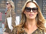 Beverly Hills, CA - Molly Sims struts her stuff through Beverly Hills while running a few errands.  The ex-model turned actress hid her bump in a pretty patterned dress as she awaits the birth of her second child.\nAKM-GSI     March 16, 2015\nTo License These Photos, Please Contact :\nSteve Ginsburg\n(310) 505-8447\n(323) 423-9397\nsteve@akmgsi.com\nsales@akmgsi.com\nor\nMaria Buda\n(917) 242-1505\nmbuda@akmgsi.com\nginsburgspalyinc@gmail.com