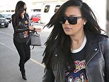 """Naya Rivera shows off her rock side in black jeans, a leather jacket & a rock and roll t-shirt with ankle-boots.  The pregnant """"Glee"""" star was spotted catching a flight out of LAX without her husband, Ryan Dorsey.  Pictured: Naya Rivera Ref: SPL977015  160315   Picture by: Splash News  Splash News and Pictures Los Angeles: 310-821-2666 New York: 212-619-2666 London: 870-934-2666 photodesk@splashnews.com"""