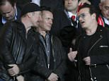 U2 band members The Edge, left, Adam Clayton, center and Bono talk before the Champions League round of 16 second leg soccer match between Monaco and Arsenal at Louis II stadium in Monaco, Tuesday, March 17, 2015. (AP Photo/Christophe Ena)