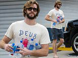 UK CLIENTS MUST CREDIT: AKM-GSI ONLY..EXCLUSIVE: A barefoot Liam Hemsworth stops by the local gas station in Malibu to stock up on a few drinks. The bearded actor had a handful of waters and a fruit drink as he returned to his Escalade on a relaxing day over the weekend.....Pictured: Liam Hemsworth..Ref: SPL977374  160315   EXCLUSIVE..Picture by: AKM-GSI / Splash News....