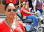 EXCLUSIVE: Pregnant Tamera Mowry rides a scooter at disneyland as she enjoys the day with her family. She was seen sitting and riding on the scooter the whole day as she spent the very hot day at disneyland while her family rode rides she stayed behind but seemed very happy the entire time. she was also seen walking around with her son Aden Houseley showing him the different areas of the park. \nTamera is 7 months pregnant according to her twitter feed\n\nPictured: Tamera Mowry and Aden Housley\nRef: SPL974228  160315   EXCLUSIVE\nPicture by: Fern / Splash News\n\nSplash News and Pictures\nLos Angeles: 310-821-2666\nNew York: 212-619-2666\nLondon: 870-934-2666\nphotodesk@splashnews.com\n