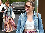 """UK CLIENTS MUST CREDIT: AKM-GSI ONLY EXCLUSIVE: Jennifer Lopez has a Sunday family day and treats her twins Max and Emme to a matinee showing of """"Cinderella"""" at the Calabasas Commons on March 15, 2015. Jennifer's manager, Benny Medina, joined them for the show and another way to beat the warm heat hitting the greater Los Angeles area right now.  Pictured: Jennifer Lopez Ref: SPL977680  160315   EXCLUSIVE Picture by: AKM-GSI / Splash News"""