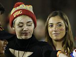 Miley Cyrus and Patrick Schwarzenegger sighting at USC football game, in a suite near the field.  And their affection for each other was in full display.  The USC Trojans were playing against the CAL Bears, at the Los Angeles Memorial Coliseum, on November 13, 2014. (Absolute Mandatory Credit: Ric Tapia / EduStarts / Splash )....Pictured: Miley Cyrus..Ref: SPL852852  131114  ..Picture by: Ric Tapia/EduStarts/Splash News....Splash News and Pictures..Los Angeles: 310-821-2666..New York: 212-619-2666..London: 870-934-2666..photodesk@splashnews.com..