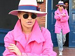 Rita Ora seen out and about in London heading to film at the itv studios for the alan carr show. Rita was seen wearing bright pink mac coat.   Pictured: Rita Ora Ref: SPL978759  180315   Picture by: Evie Arabella / Splash News  Splash News and Pictures Los Angeles: 310-821-2666 New York: 212-619-2666 London: 870-934-2666 photodesk@splashnews.com