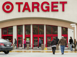 FILE - In this Dec. 19, 2013, file photo, shoppers arrive at a Target store in Los Angeles. Target has proposed to pay $10 million to settle a class-action lawsuit brought against it following a massive data breach in 2013. (AP Photo/Damian Dovarganes, File)