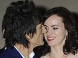 Sealed with a kiss Ronnie Wood and his new bride Sally Humphreys  leave the Dorchester.  . REXMAILPIX.