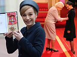 Dame Kristin Scott Thomas is made a Dame Commander of the British Empire by Queen Elizabeth II during an Investiture ceremony at Buckingham Palace, London. PRESS ASSOCIATION Photo. Picture date: Wednesday March 19, 2015. See PA story ROYAL Investiture. Photo credit should read: Jonathan Brady/PA Wire