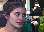 UK CLIENTS MUST CREDIT: AKM-GSI ONLY EXCLUSIVE: Calabasas, CA - A fresh faced Kylie Jenner was seen wearing what appears to be an engagement ring while shopping at Sephora in Calabasas. The reality star covered her makeup free face with her left hand revealing a gold ring with a large diamond, could Kylie be the next Kardashian to wed?  Pictured: Kylie Jenner Ref: SPL979591  180315   EXCLUSIVE Picture by: AKM-GSI / Splash News