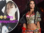 LONDON, ENGLAND - DECEMBER 02:  Shanina Shaik walks the runway at the annual Victoria's Secret fashion show at Earls Court on December 2, 2014 in London, England.  (Photo by Karwai Tang/WireImage)