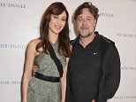 """LONDON, ENGLAND - MARCH 18:   Actress Olga Kurylenko (L) and actor/director Russell Crowe attend """"The Water Diviner"""" photocall at Claridge's Hotel on March 18, 2015 in London, England.  Pic Credit: Dave Benett"""