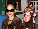Rihanna was spotted in a heavily painted fur coat, arriving at Pier 59 studios in New York.  The star wore shades and a dress with sneakers, on Thursday, March 19, 2015 X17online.com