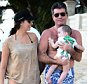 Simon Cowell holds baby Eric on the beach in Barbados.  Pictured: Simon Cowell, Eric Cowell and Lauren Silverman Ref: SPL915082  191214   Picture by: Splash News  Splash News and Pictures Los Angeles: 310-821-2666 New York: 212-619-2666 London: 870-934-2666 photodesk@splashnews.com