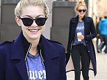 ***MANDATORY BYLINE TO READ INFPhoto.com ONLY***\nGigi Hadid photographed with her boxing trainer heading to the gym in New York City this morning.\n\nPictured: Gigi Hadid\nRef: SPL979965  190315  \nPicture by: INFphoto.com\n\n