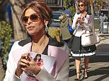 EXCLUSIVE: Eva Mendes takes a photo of the Carlyle Hotel while exiting after having brunch in New York City.  Pictured: Eva Mendes Ref: SPL979523  190315   EXCLUSIVE Picture by: Splash News  Splash News and Pictures Los Angeles: 310-821-2666 New York: 212-619-2666 London: 870-934-2666 photodesk@splashnews.com