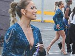 UK CLIENTS MUST CREDIT: AKM-GSI ONLY EXCLUSIVE: Latina babe Jennifer Lopez looks pretty wearing a blue patterned romper showing of her legs and beige designer shoes as she gets ready to shoot 'America Idol' in West Hollywood, CA.  Pictured: Jennifer Lopez Ref: SPL980358  190315   EXCLUSIVE Picture by: AKM-GSI / Splash News