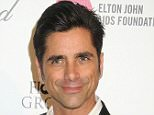 ADM_ELTONJOHNOSCAR15_BP_ - Celebrities attend the 23rd Annual Elton John Oscar Viewing Party held at West Hollywood Park.....Pictured: John Stamos..Ref: SPL959886  220215  ..Picture by: AdMedia / Splash News....Splash News and Pictures..Los Angeles: 310-821-2666..New York: 212-619-2666..London: 870-934-2666..photodesk@splashnews.com..