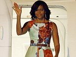 U.S. first lady Michelle Obama arrives at Siem Reap International Airport on Friday, March 20, in Siem Reap, Cambodia. Mrs. Obama's Friday evening arrival in Cambodia comes after a three-day visit to Japan. (AP Photo/Wong Maye-E)