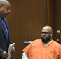 """FILE - In this Monday, March 9, 2015 file photo, Marion """"Suge"""" Knight, right, appears with his attorney Matthew Fletcher, left, in court for a hearing about evidence in his murder case in Los Angeles, Calif.  Los Angeles prosecutors are asking a judge to set bail in a murder case against the former rap music mogul Knight at $25 million citing his violent history. The motion filed by Deputy District Attorney Cynthia Barnes on Thursday, March 19, 2015, cites 31 incidents in which Knight is accused of threatening others or using violence.  (AP Photo/Kevork Djansezian, Pool, File)"""