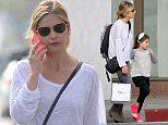 UK CLIENTS MUST CREDIT: AKM-GSI ONLY EXCLUSIVE: Sarah Michelle Gellar walks with her daughter Charlotte in Santa Monica, looking casual and comfy in a baggy white shirt, skinny jeans and suede Isabel Marant booties. The doting mother held her little girl's hands as they crossed the crosswalk, and even carried Charlotte's backpack in addition to her own Gucci bag.  Pictured: Sarah Michelle Gellar and Charlotte Prinze Ref: SPL980015  190315   EXCLUSIVE Picture by: AKM-GSI / Splash News