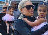 Kim Kardashian carries her little ballerina North West as she meets up with sister Courtney and Penelope for a dance class in woodland hills. Kourtney's youngest son reign was also brought along, in a car seat, dropped with a blanket with crowns on it\n\nPictured: Kim Kardashian, Kourtney Kardashian, Penelope Disick, North West, Kanye West and Reign Disick\nRef: SPL979639  190315  \nPicture by: Fern / splash news\n\nSplash News and Pictures\nLos Angeles: 310-821-2666\nNew York: 212-619-2666\nLondon: 870-934-2666\nphotodesk@splashnews.com\n