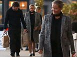 UK CLIENTS MUST CREDIT: AKM-GSI ONLY\nEXCLUSIVE: Expecting parents Lara Bingle and Sam Worthington are in good spirits as they leave a vintage market in Malibu.  The 'Avatar' actor kept close to his partner as he left the market with two shopping bags in hand. Lara gave a glimpse of her bulging baby bump beneath a tweed coat and black dress.\n\nPictured: Lara Bingle, Sam Worthington\nRef: SPL980509  190315   EXCLUSIVE\nPicture by: AKM-GSI / Splash News\n\n