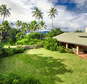 """This undated photo provided by LIST Sotheby's International Realty shows a home in Waimanalo, Hawaii once used for the filming of the 1980s television show """"Magnum, P.I."""" The 3-acre oceanfront property has sold for $8.7 million to a close friend of President Barack Obama. (AP Photo/Eric Mansperger/LIST Sotheby's International Realty)"""