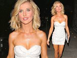 Joanna Krupa wore a low-cut white dress for dinner at Craig's in West Hollywood.  The model and reality star has also recently cut her hair short.  Friday, March 20, 2015 X17online.com