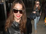 """""""Game of Thrones"""" actress, Emilia Clarka is all smiles as she arrives in Los Angeles.  The sexy English actress was seen wearing a leather jacket, blue jeans and leopard-print open-toed shoes.  Pictured: Emilia Clarke Ref: SPL980543  200315   Picture by: Splash News  Splash News and Pictures Los Angeles: 310-821-2666 New York: 212-619-2666 London: 870-934-2666 photodesk@splashnews.com"""
