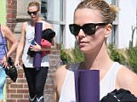 Charlize Theron seen leaving a yoga class with a female friend.\nFeaturing: Charlize Theron\nWhere: Los Angeles, California, United States\nWhen: 20 Mar 2015\nCredit: Michael Wright/WENN.com