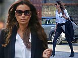 MUST BYLINE: EROTEME.CO.UK Melanie Sykes shows off her toned legs in a black shorts suit while running errands in Hampstead. EXCLUSIVE    March 20,  2015 Job: 150320L11    London, England EROTEME.CO.UK 44 207 431 1598