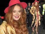 Picture Shows: Lindsay Lohan  March 21, 2015    Actress Lindsay Lohan seen arriving at DSTRKT for a night out in London, UK. The 'Liz & Dick' star rocked a fur coat over a red lacy dress, a matching red hat, and nude platform heels.    Non Exclusive  WORLDWIDE RIGHTS    Pictures by : FameFlynet UK    2015  Tel : +44 (0)20 3551 5049  Email : info@fameflynet.uk.com
