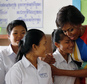 """U.S. first lady Michelle Obama hugs Sohang Vean, a student at a local high school she was visiting, Saturday, March 21, 2015, on the outskirts of Siem Reap, Cambodia. Mrs. Obama is in Cambodia to promote the education initiative """"Let Girls Learn,"""" which was launched to lift barriers that block more than 62 million girls around the world from attending school. (AP Photo/Wong Maye-E)"""