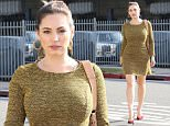 Picture Shows: Kelly Brook  March 21, 2015\n \n 'One Big Happy' actress Kelly Brook seen stopping by a friend's house in Santa Monica, California. Kelly showed off her curves in a flared yellow mini dress paired with bright red pumps.\n \n Non Exclusive\n UK RIGHTS ONLY\n \n Pictures by : FameFlynet UK © 2015\n Tel : +44 (0)20 3551 5049\n Email : info@fameflynet.uk.com