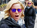 UK CLIENTS MUST CREDIT: AKM-GSI ONLY\nEXCLUSIVE: A tired Elizabeth Banks takes a afternoon stroll with friends in New York. 'The Hunger Games' and 'Modern Family' star has every good reason to be a bit tired, for she has been hard at work with her big screen work as well as her new television series, 'Wet Hot American Summer: First Day of Camp'.\n\nPictured: Elizabeth Banks\nRef: SPL981798  210315   EXCLUSIVE\nPicture by: AKM-GSI / Splash News\n\n