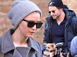March 22, 2015: Bradley Cooper and Jennifer Lawrence photographed leaving their hotel in the Tribeca district of New York City this afternoon. \nMandatory Credit: INFphoto.com Ref.: infusny-198