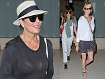 Newly single Kris Jenner arriving from Cancun after trip with friend Melanie Griffith and Dakota Johnson march 21, 2015 X17online.com