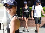 EXCLUSIVE: Giuliana Rancic of E Entertainment and Fashion Police is spotted wearing a t-shirt that says I Love Sundays as she and husband Bill Rancic head to their car after having lunch at Burger Lounge in Brentwood, Ca  Pictured: Giuliana Rancic and Bill Rancic Ref: SPL981843  210315   EXCLUSIVE Picture by: GoldenEye /London Entertainment  Splash News and Pictures Los Angeles: 310-821-2666 New York: 212-619-2666 London: 870-934-2666 photodesk@splashnews.com