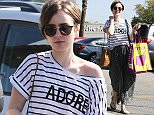 Picture Shows: Lily Collins  March 22, 2015    'Love, Rosie' actress Lily Collins is all smiles while shopping at Whole Foods in West Hollywood, California.    Perhaps Lily is in good spirits because she is rumoured to be dating 'Avengers' star Chris Evans!    Exclusive - All Round  UK RIGHTS ONLY    Pictures by : FameFlynet UK    2015  Tel : +44 (0)20 3551 5049  Email : info@fameflynet.uk.com