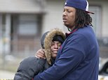 Carmon Lisenby, left, and Corey Bryant, both family members, console each other near a home on North Harding Street in Indianapolis, at a scene involving four homicide victims, Tuesday, March 24, 2015. Indianapolis Police Chief Rick Hite says three women and a man have been shot to death in the home. Hite says the shootings don't appear random and likely occurred Tuesday morning. (AP Photo/The Indianapolis Star, Robert Scheer)