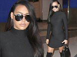 """Naya Rivera shows off her baby bump in a very tight black dress as she catches a flight out of of Los Angeles without husband, Ryan Dorsey.  The pregnant """"Glee"""" star was seen at LAX in a cute dress showing off her baby bump.\n\nPictured: Naya Rivera\nRef: SPL982816  230315  \nPicture by: Splash News\n\nSplash News and Pictures\nLos Angeles: 310-821-2666\nNew York: 212-619-2666\nLondon: 870-934-2666\nphotodesk@splashnews.com\n"""