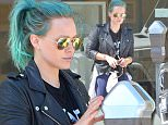 Hilary Duff Feeds Her Meter in Beverly Hills With Her Blue Hair\n\nPictured: Hilary Duff\nRef: SPL982665  230315  \nPicture by: Photographer Group / Splash News\n\nSplash News and Pictures\nLos Angeles: 310-821-2666\nNew York: 212-619-2666\nLondon: 870-934-2666\nphotodesk@splashnews.com\n