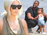 *EXCLUSIVE* Malibu, CA - Kim Kardashian, Kanye West and baby North dined out at celeb hotspot Nobu on Sunday afternoon for a little lunch with a view. The trio looked happier than ever to be spending time as a family, with Kanye even acting like a doting daddy and taking little Nori down to the beach to play. Kim stayed up by the restaurant to watch since her ensemble was a little less than beach-appropriate! The reality starlet showed off her famous curves in a head-to-toe olive green ensemble, accessorizing with a patterned clutch and her favorite Manolo Blahnik sandals.\nAKM-GSI       March 22, 2015\nTo License These Photos, Please Contact :\nSteve Ginsburg\n(310) 505-8447\n(323) 423-9397\nsteve@akmgsi.com\nsales@akmgsi.com\nor\nMaria Buda\n(917) 242-1505\nmbuda@akmgsi.com\nginsburgspalyinc@gmail.com