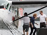 March 24, 2015: Ed Sheeran returns to Sydney Harbour on a seaplane after filming 'Home & Away'  in Sydney, Australia. Mandatory Credit: INFphoto.com Ref: infausy-10/42/50