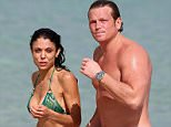 ***MANDATORY BYLINE TO READ INFphoto.com ONLY***..Bethenny Frankel looks amazing in a green string bikini on the beach with boyfriend Michael Cerussi on New Year's Eve Day. The two even engaged in some PDA while taking a swim in the ocean.....Pictured: Bethenny Frankel; Michael Cerussi..Ref: SPL919432  311214  ..Picture by: INFphoto.com....