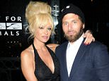 Pamela Anderson wraps her arm around husband Rick Salomon at 'Mercy For Animals' Gala in LA! Pamela Anderson was seen spending quality time with her husband at the 15th Anniversary Gala in Los Angeles shortly before sitting down for dinner. Pam who won an award at the bash for her contribution to the charity was seen posed up with her recently remarried husband. Leon Lewis was also in attendance as guests enjoyed the party and after party at The London Hotel in West Hollywood!  Pictured: Pamela Anderson, Rick Salomon Ref: SPL841885  130914   Picture by: Splash News  Splash News and Pictures Los Angeles: 310-821-2666 New York: 212-619-2666 London: 870-934-2666 photodesk@splashnews.com