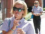 Beverly Hills, CA - Lily Allen enjoys a smoke while shopping with a friend around Beverly Hills. The English singer-songwriter dressed down for some retail therapy in a striped shirt with black lose pants and sneakers with mirrored shades.\n \nAKM-GSI    March  24, 2015\nTo License These Photos, Please Contact :\nSteve Ginsburg\n(310) 505-8447\n(323) 423-9397\nsteve@akmgsi.com\nsales@akmgsi.com\nor\nMaria Buda\n(917) 242-1505\nmbuda@akmgsi.com\nginsburgspalyinc@gmail.com